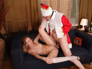 Gorgeous young blonde gets to fuck Santa Claus